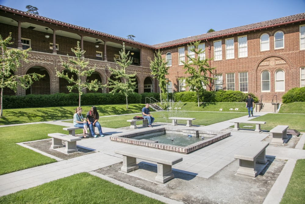 students sitting in courtyard